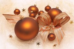 Christmas decorations, brown baubles, composition with bow Stock Images