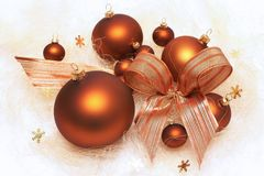 Christmas decorations, brown baubles, composition with bow Royalty Free Stock Photos