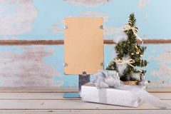 Christmas decorations with brown paper for text on grunge blue Stock Photo