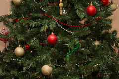 Christmas Decorations. Christmas bulb decorations hanging from an artificial Christmas tree Stock Images