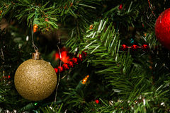 Christmas Decorations. Christmas bulb decorations hanging from an artificial Christmas tree Royalty Free Stock Images