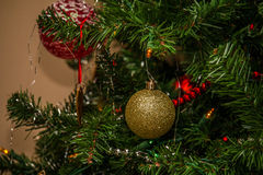 Christmas Decorations. Christmas bulb decorations hanging from an artificial Christmas tree Royalty Free Stock Photos