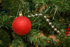 Christmas Decorations. Christmas bulb decorations hanging from an artificial Christmas tree Royalty Free Stock Image