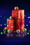 Christmas decorations bulb and lights with gift Stock Photography