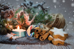 Christmas decorations with burning candle Stock Photos