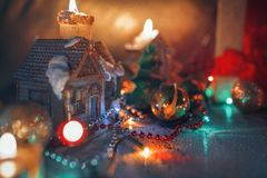 Christmas decorations, burning candles, garlands, lights Royalty Free Stock Images