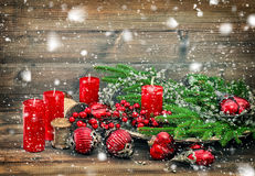 Christmas decorations burning candles vintage falling snow Stock Images