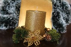 Christmas candle in gold stock photos