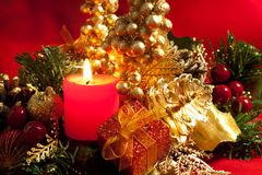 Christmas decorations with a candle Stock Images