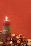 Christmas decorations and candle. In warm colors Stock Photos