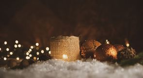 Christmas decorations. Candle with golden spheres royalty free stock images