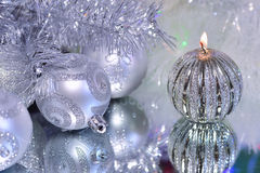 Christmas decorations with candle and silver balls. Royalty Free Stock Images