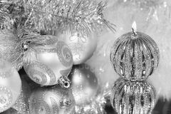 Christmas decorations with candle and silver balls. Royalty Free Stock Photo