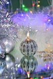 Christmas decorations with candle and silver balls. Royalty Free Stock Photography