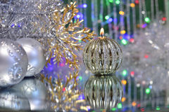 Christmas decorations with candle and silver balls. Stock Images