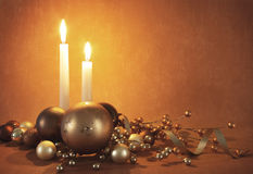 Christmas decorations and candles. Christmas decorations baubles and candles Stock Photo