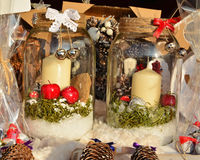 Christmas decorations with candles, apples, bells Stock Photography