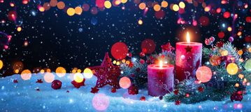 Christmas Decorations With Candles and Colored Lights Effects royalty free stock photos