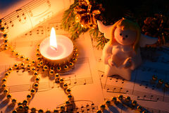 Christmas decorations, candles, figures of angels and notes Royalty Free Stock Photo