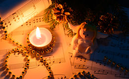 Christmas decorations, candles, figures of angels and notes Royalty Free Stock Images