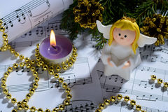 Christmas decorations, candles, figures of angels and notes Stock Image