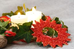 Christmas Decorations with Candles and Ivy. On Sacking Royalty Free Stock Photo