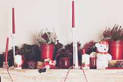 Christmas decorations with candles on mantelpiece Royalty Free Stock Photography