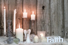 Christmas decorations and candles by wood background Royalty Free Stock Photography