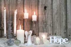 Christmas decorations and candles by wood background Stock Images