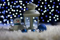 Christmas decorations with a candlestick and a snowman royalty free stock image