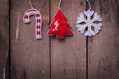 Christmas  decorations  candy cane,  tree and snowflake on aged Stock Photography