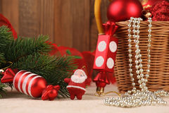 Christmas decorations and candy Santa Claus near fir branches Royalty Free Stock Photos