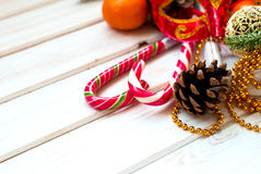 Christmas decorations, candy sticks, mask, bumps on the wooden t Stock Images