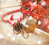 Christmas decorations, candy sticks, mask, bumps on the wooden t Stock Photo