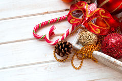 Christmas decorations, candy sticks, mask, bumps on the wooden t Royalty Free Stock Image