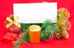 Christmas decorations with card on red Stock Image