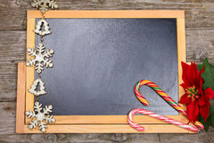 Christmas decorations on the chalkboard. Stock Image