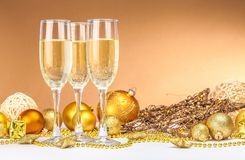 Christmas Decorations with Champagne Flutes. Champagne christmas decorations flutes isolated beverages celebration drinks Royalty Free Stock Photos