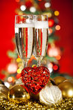 Christmas decorations and champagne glass Royalty Free Stock Photos