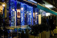 Christmas decorations. On a Greek tavern during the holiday seasons in Greece Royalty Free Stock Photo