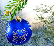 Christmas decorations on the Christmas tree on the green background close-up Stock Image