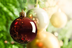 Christmas decorations on Christmas tree - Selective focus. On the closest one Stock Image