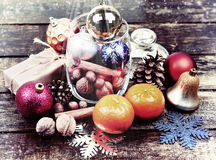 Christmas decorations, cinnamon, jar with nuts.Walnuts, hazelnuts.Toned image. Selective field of focus. Stock Photography