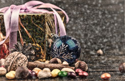 Christmas decorations, cinnamon, nuts,candies.Walnuts, hazelnuts.Toned image.Snow drawn Stock Images
