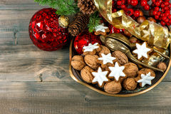 Christmas decorations with cinnamon star cookies and walnuts Royalty Free Stock Photos