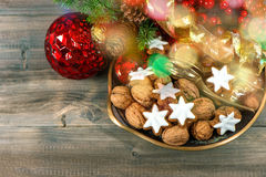 Christmas decorations with cinnamon star cookies and walnuts Stock Photography