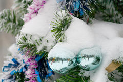 Christmas decorations close-up winter. Christmas decorations close-up with tinsel and snow green balls Royalty Free Stock Photo
