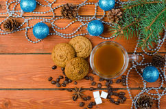 Christmas decorations and coffee on a wooden table. Royalty Free Stock Images