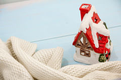 Christmas decorations concept of preparing turquoise shabby wooden table. cozy knitted blanket and cabin concept winter holiday. p Stock Images