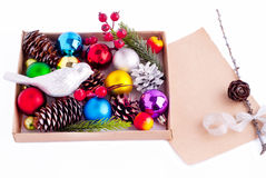 Christmas decorations - cones, balls, berries and paper. With fir tree branch Stock Photos